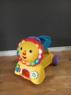 Fisher Price walk and ride on toy