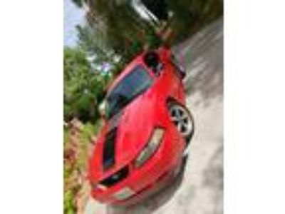 2003 Ford Mustang Mach 1 Red Mach 1 Mustang , 1 owner, runs good.