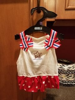 New with tags adorable red white and blue can be worn for Fourth of July or any time. size small see size chart in pics