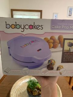 Never used cake pop maker and stand.