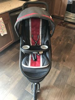 Graco Fast Action Jogger Travel System.