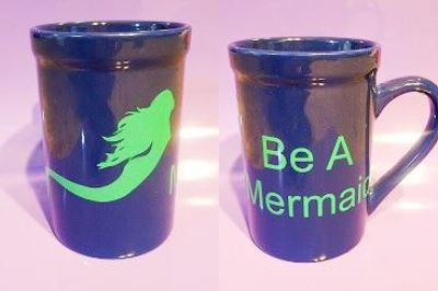 "Be A Mermaid - blue ceramic mug with a green mermaid and the words ""Be A Mermaid"" - 16 ounces"