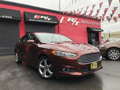 2016 Ford Fusion 4dr Sdn SE FWD (Ruby Red Metallic Tinted Clearcoat)