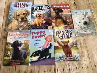 Lot of 7 puppy and dog chapter books. One is hardback. Summer reading EUC $7