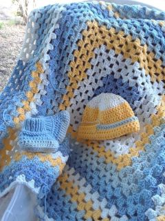 Crochet baby blanket, baby booties and beanie