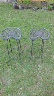 Two tractor seat bar stoolS