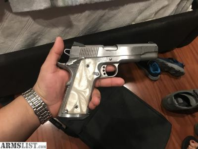 For Sale: Springfield 1911 Stainless with pearl grips extras