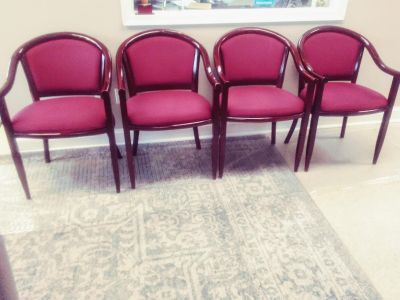 Burgundy Armchairs. Cherry wood finish. In used Condition? 12 chairs. Some nicks.