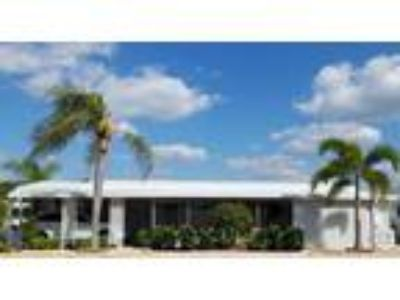 Two BR Two BA Gorgeous Renovated Home in SE Florida with Gulf access at