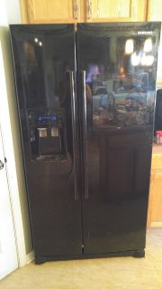 REDUCED TO*** $500.00 LARGE 27 CU. Samsung side by side refrigerator