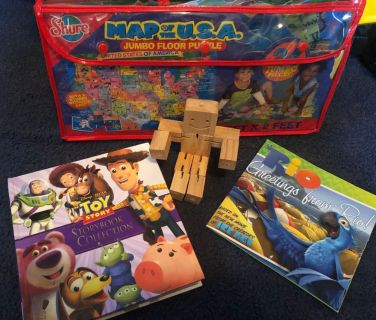 4 item lot-Hardcover Toy Story Storybook Collection, Movable wooden figure, Paperback Rio book, Jumbo Floor Puzzle Map of the USA