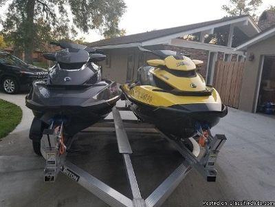 Pair of Seadoo GTX jetskies and trailer