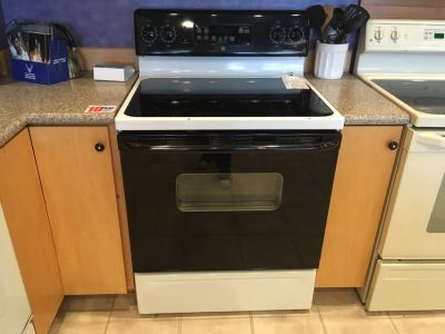 GE Black and White Electric Range (Smooth Cooktop) - USED