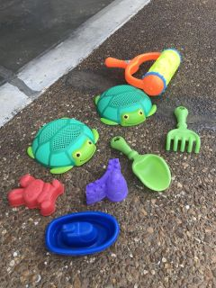 Lot of sand toys- sifters, a roller, a boat, shover and rake