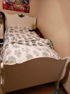 twin bed with all bedding