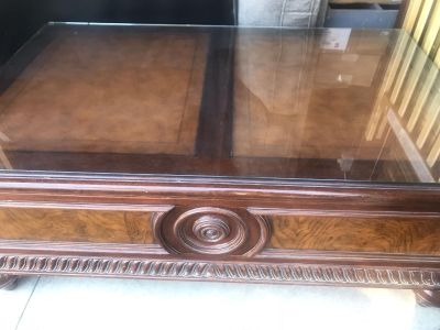 Ethan Allen coffee table with glass top.