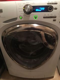 GE Profile HE Washer and Dryer set with matching pedestal drawers (not shown)