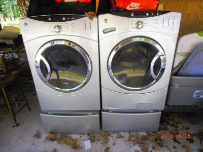 GE Washer/Dryer with Stands.