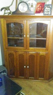 Wood stained corner cabinet