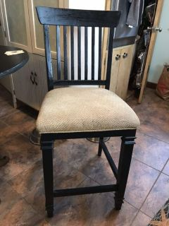Four solid wood counter height stools