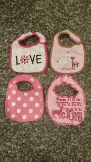 Lot of 9 Baby Girl Bibs for $2.00. All Velcro & snaps work great! Very very minimal have stains or discoloration. No Smoke/No Pets.