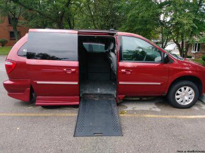 Wheel Chair Accessible Van with Rollx in Floor Ramp