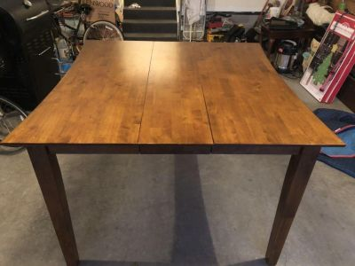 Counter height table with leaf extension