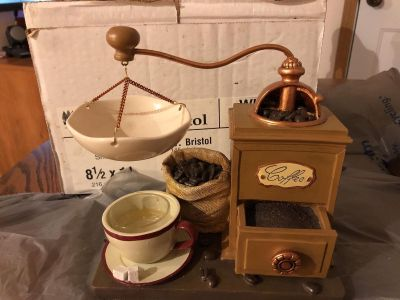 Coffee grinder candle piece. Holds tea light in cup.