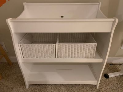Baby changing table with baskets