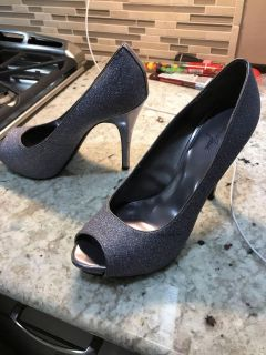 Sparkly silver high heel shoes
