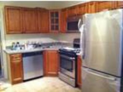 This great Five BR, 2.50 BA sunny apartment is located in the Tufts University