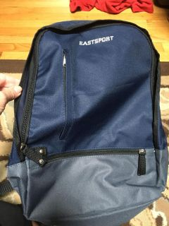 East Sport mainly navy blue lighter weight bsck pack. Looks unused. Excellent for camping. Biking or school.