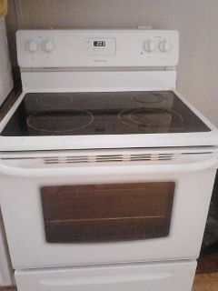 $200,  White Frigidaire glass top stove