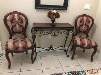 Two padded chair and table