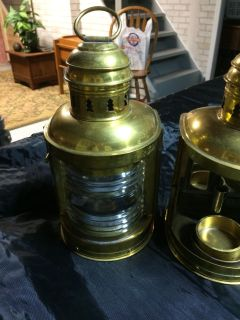 One pair of brass and glass ship lanterns.