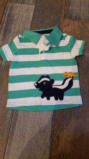 Gymboree skunk polo 0-3m. Super cute. Skunk is velvety. New without tags