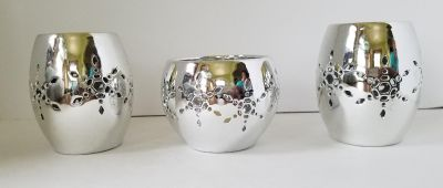Set of 3 silver candleholders or oil warmers