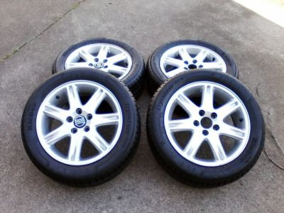 Volvo Wheels & Tires - 7 spoke Aluminum Alloy Rim w/ silver finish. Qty: 4