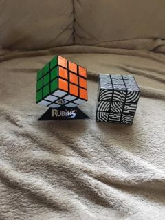Lot of 2 Rubik's Cubes (and one Stand)