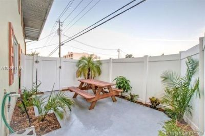 QUIET SECURE BUILDING INCLUDES A BIG PATIO WITH WOODEN FENCE.