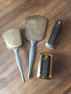 Vintage mirror and brush set with additional brushes.