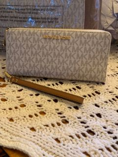 Mk authentic travel continental wallet