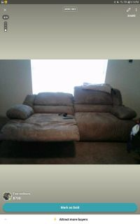 There are two couches both of them reclines all three sides