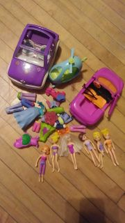 Polly pocket dolls and items