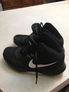 Boys size 7.5 Nike Precision tennie shoes. Light weight fabric not leather.