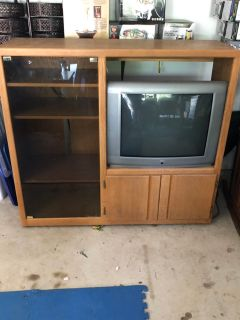 53x49x16 inch entertainment cente. Real wood. A few water rings on top but otherwise great condition Has Smokey glass door