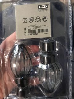 IKEA finials for a curtain rod. New never used, but package was opened. Black and glass.