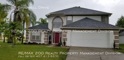 TWO STORY HOME CONVENIENTLY LOCATED / MINUTES FROM OIA
