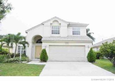1252 NW 143 Ave Pembroke Pines Four BR, Spectacular home located