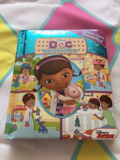 Like new (small padded metallic color) Disney Doc Mcstuffins little first look and find book